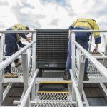Accessing evaporative coolers on steep roofs made easy with a Defender™ HVAC access system.